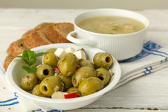 Soup with olives and brown bread Royalty Free Stock Photos