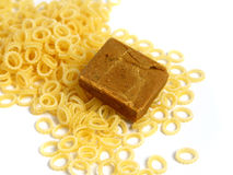 Soup pasta with flavor. Pasta to Soup with a block of a dehydrated flavor on a white background stock photography