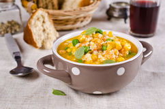 Soup with pasta. And vegetables on textile background. Selective focus Stock Photos