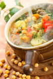 Soup with peas and vegetables. Tasty soup with peas and vegetables in the jug Stock Image