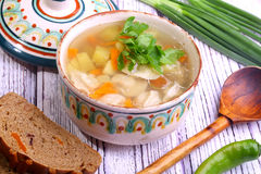 Soup with pelmeni, a potato, carrots submitted with a green onio. Ns and pepper royalty free stock images