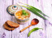 Soup with pelmeni, a potato, carrots submitted with a green onio. Ns and pepper royalty free stock image