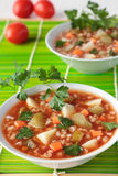Soup with pickled cucumbers, barley  and tomato paste Royalty Free Stock Image