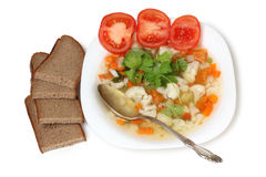 Soup on plate and bread Royalty Free Stock Images