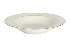 Soup plate with a gold border Royalty Free Stock Photos