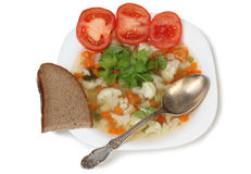 Soup on plate and spoon Royalty Free Stock Image