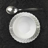 Soup plate and spoon Royalty Free Stock Image