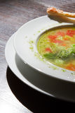 Soup in a plate on the table Stock Photos