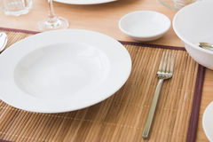 Soup plate on table Stock Images