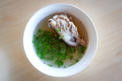 Soup pork bone. Soup with pork bone with coriander on the bowl royalty free stock photo