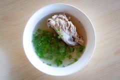 Soup pork bone. Soup with pork bone with coriander on the bowl Royalty Free Stock Photo