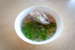Soup pork bone. Soup with pork bone with coriander on the bowl stock image