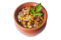 Soup pot with smoked sausage potatoes and corn stock images