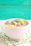 Soup with potatoes, rice and meatballs in a white cup Royalty Free Stock Image