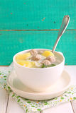 Soup with potatoes, rice and meatballs in a white cup Royalty Free Stock Photos