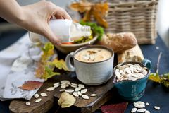 Soup with pumpkin and cream. Autumn meal. Delicious food for lunch. Soup with pumpkin and cream. Autumn meal. Delicious food for lunch stock photo