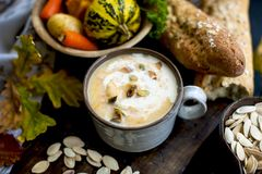 Soup with pumpkin and cream. Autumn meal. Delicious food for lunch. Soup with pumpkin and cream. Autumn meal. Delicious food for lunch stock image