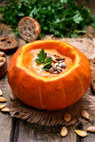 Soup in pumpkin Stock Photos