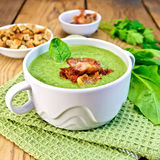 Soup puree with bacon and croutons on board Royalty Free Stock Photography