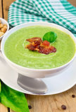 Soup puree with bacon and spoon on board Royalty Free Stock Images