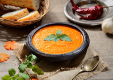 Soup puree of carrot, pepper, greens, vintage spoon on a wooden background. Soup puree of carrot, pepper, greens, vintage spoon Royalty Free Stock Image