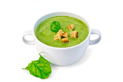 Soup puree with croutons and spinach in bowl Stock Photo