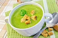 Soup puree with croutons and spinach on napkin Royalty Free Stock Images