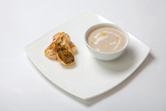 Soup puree mushrooms in a deep white plate Royalty Free Stock Image