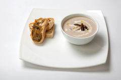 Soup puree mushrooms in a deep white plate Stock Photos