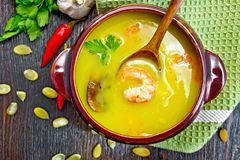 Soup-puree pumpkin with prawns and champignons on board top Stock Photos