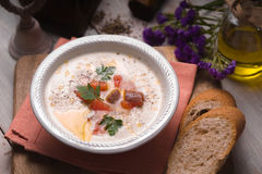 Soup puree with salmon in a ceramic bowl closeup Royalty Free Stock Images