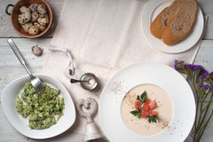 Soup puree with salmon and an omelette on the table copy space Royalty Free Stock Photos