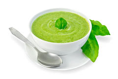 Soup puree with spinach in a bowl and leaves Royalty Free Stock Photography