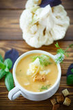 Soup pureed cauliflower. In a plate on the table Stock Images