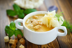 Soup pureed cauliflower. In a plate on the table Stock Photo