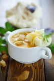 Soup pureed cauliflower. In a plate on the table Royalty Free Stock Photo