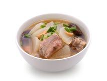 Soup radish with pork serve on bowl. Thai food isolated on white background stock photo