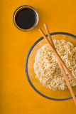 Soup Ramen noodles in bowl and soy sause. Vertical stock photos