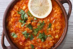 Soup with red lentils and tomatoes macro horizontal. top view Stock Image