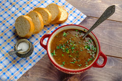 Soup. Rustic soup with bread on the desk background Royalty Free Stock Photos