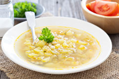 Soup with salted cucumbers and pearl barley Stock Photography