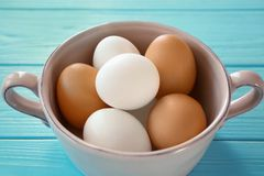 Soup saucer with hard boiled eggs on blue wooden table. Nutrition concept Stock Image