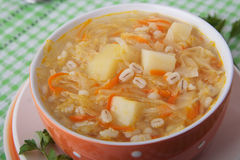 Soup of sauerkraut with pearl barley and potatoes Stock Image