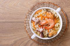 Soup from seafood with the Chinese noodles. top view Stock Photography