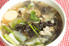 Soup with seaweed and minced pork Stock Photo