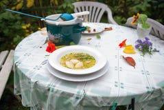 Soup with semoline dumpling Stock Photo