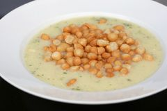 Soup served with fried batter pearls. Cream vegetable soup served with fried batter pearls (Backerbse), a sort of crouton, popular in Stock Photo