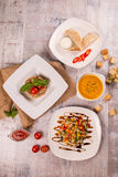 Soup, shawarma salad covered dining table stock photography