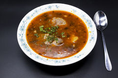 Soup Shurpa. Meat soup beef with pepper and tomato. Traditional dishes from the middle East, Asia. Stock Photos