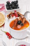 Soup with smoked meat, olives and lemon. Solyanka soup Stock Photo